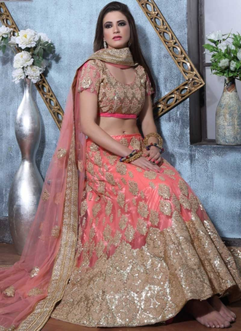 56e6a4305c Peach Sequins Work Zari Work Lace Border Net A-Line Party Wear Lehenga Choli