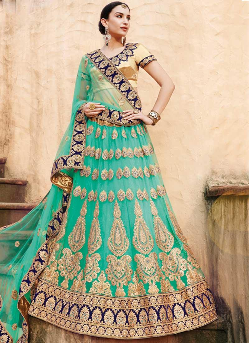 f7fbc43b77 Turquoise Embroidery Sequins Work Stone Work Net Designer Bridal Lehenga  Choli