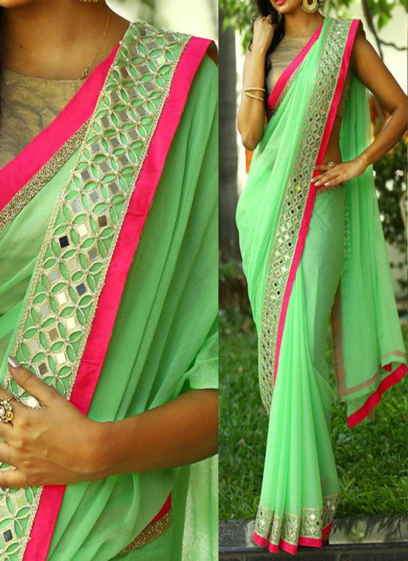 pista green mirror work border lace georgette banarasi designer