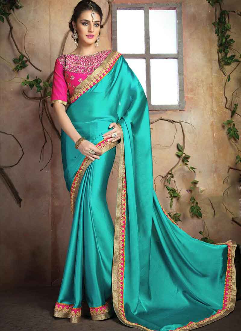 b26d1ba398 Stunning Teal Lace Border Stone Work Silk Party Wear Sarees. buy ...