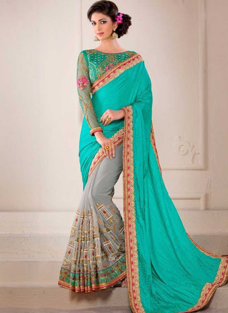 bcff04362d Dazzling Turquoise Grey Embroidery Work Pure Silk Fancy Fabric Wedding  Sarees