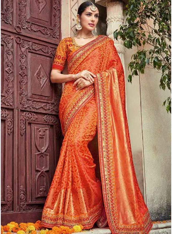 57bab658d4 Orange Embroidery Mirror Work Silk Fancy Designer Wedding Bandhani Sarees
