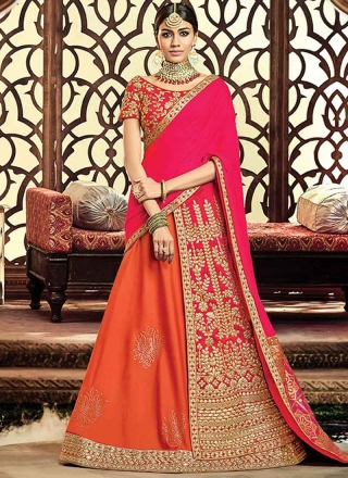 0517abf477 Orange Pink Heavy Embroidery Zari Work Raw Silk Designer Party Wear Lehenga  Choli