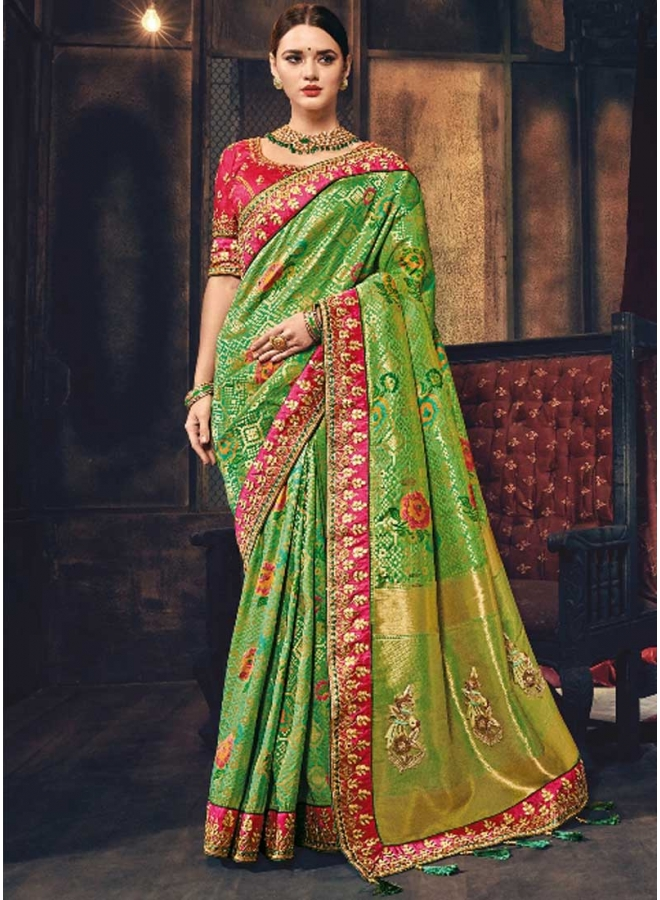 Red Sea Green Embroidery Work And Flower Printed Designer Wedding Saree