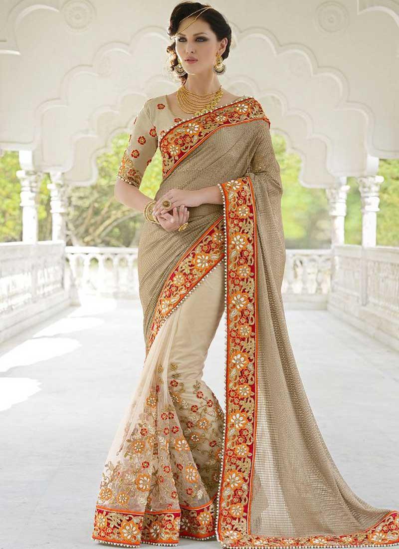 Cream embroidery work moti fancy net wedding designer